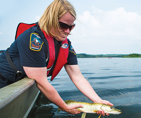 CVC's Yasmine Slater at Island Lake Conservation Authority with a catch-and-release pike.  PHOTO CREDIT Shayne Gray
